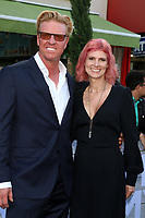 """LOS ANGELES - JUN 10:  Jake Busey, April Hutchonson at the """"Murder Mystery"""" Premiere at the Village Theater on June 10, 2019 in Westwood, CA"""