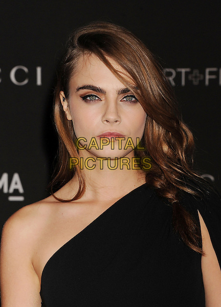 LOS ANGELES, CA - NOVEMBER 01: Actress Cara Delevingne attends the 2014 LACMA Art + Film Gala honoring Barbara Kruger and Quentin Tarantino presented by Gucci at LACMA on November 1, 2014 in Los Angeles, California.<br /> CAP/ROT/TM<br /> &copy;Tony Michaels/Roth Stock/Capital Pictures