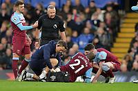 Angelo Ogbonna of West Ham United needs treatment during Chelsea vs West Ham United, Premier League Football at Stamford Bridge on 30th November 2019