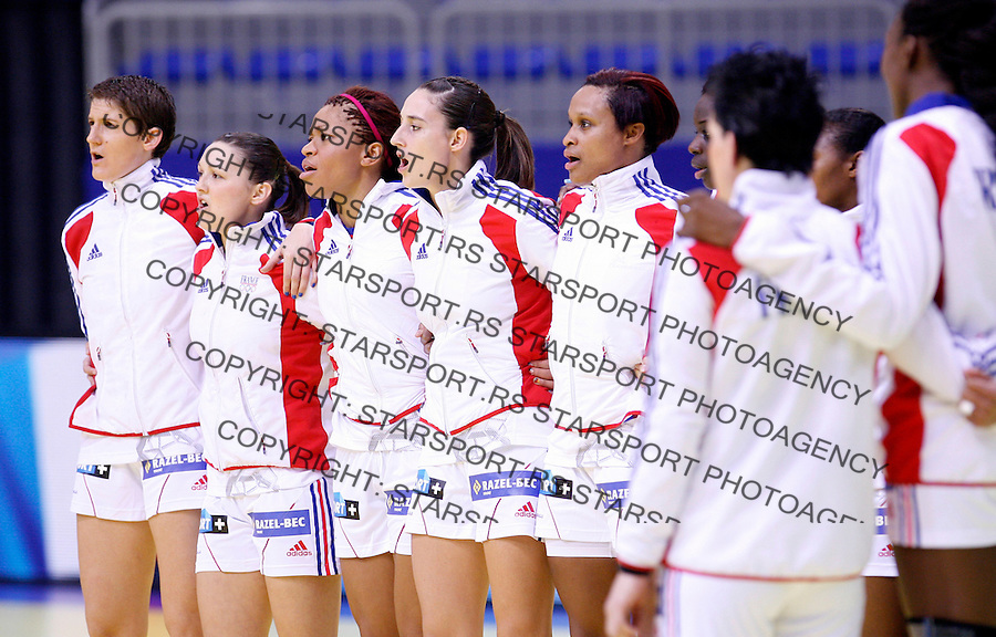 NIS, SERBIA 4/12/2012/ France national handball team players sings national anthem before start of Women`s European Handball Championship Group B match between France and FYR Macedonia (FYROM) in Cair arena in city of Nis in southern Serbia on  December 4, 2012 Credit: PEDJA MILOSAVLJEVIC/SIPA/