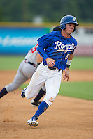 Ben Johnson (6) of the Burlington Royals hustles towards third base against the Danville Braves at Burlington Athletic Park on July 12, 2015 in Burlington, North Carolina.  The Royals defeated the Braves 9-3. (Brian Westerholt/Four Seam Images)