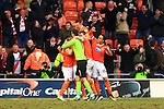 Blackpool's David Ferguson is mobbed following scoring his sides fourth goal - Blackpool vs. Nottingham Forest - Skybet Championship - Bloomfield Road - Blackpool - 14/02/2015 Pic Philip Oldham/Sportimage