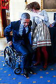 United States President Barack Obama tries an attachable lever that can make wheelchair movements easier and less tiring that was created by Kaitlin Rees (C) from Dover, Massachusetts, at the White House, in Washington, DC, on March 23, 2015. The 2015 White House Science Fair is a celebration of students winners of STEM (Science, technology, engineering and math) competitions from across the country.<br /> Credit: Aude Guerrucci / Pool via CNP