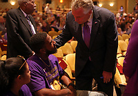 Virginia Governor Terry McAuliffe greet Marcus Martin and his fiancé during a memorial for Heather Heyer Wed., August 16, 2017, at the Paramount Theater in Charlottesville, Va. Heyer was killed the previous weekend when a vehicle drove into a crowd of counter-protestors after the Unite The Right rally. Photo/Andrew Shurtleff