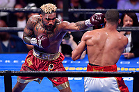 """Fairfax, VA - May 11, 2019: Jarrett """"Swift"""" Hurd throws a jab against Julian J-Rock"""" Williams during Jr. Middleweight title fight against  at Eagle Bank Arena in Fairfax, VA. Julian Williams defeated Hurd to take home the IBF, WBA and IBO Championship belts by unanimous decision. (Photo by Phil Peters/Media Images International)"""