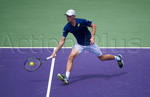 02.04.2016. Key Biscayne, Florida, USA. Miami Open tennis tournament, Mens semi-finals, Novak Djokovic versus David Goffin.   David Goffin of Belgium returns to Novak Djokovic. Djokovic won in 2 sets to make the final