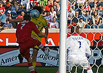 Columbus Crew Guillermo Barros Schelotto puts a header past Logan Pause and goalie Jon Busch of the Chicago Fire for a goal in the sixty first minute of play at Toyota Park.