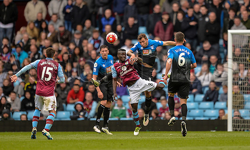 09.04.2016. Villa Park, Birmingham, England. Barclays Premier League. Aston Villa versus Bournemouth. Idrissa Gana of Aston Villa and Steve Cook of Bournemouth challenge in the air.