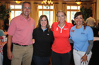 NWA Democrat-Gazette/CARIN SCHOPPMEYER Tony Engle (from left), Kelly Kemp, Brooke Pancake, LPGA pro, and Tina Hodne attend The Jones Center's Golf Event on Monday at Springdale Country Club.