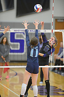NWA Democrat-Gazette/ANDY SHUPE<br /> Fayetteville's Ella May Powell (15) sends the ball over the net past Har-Ber's Mackenzie White Wednesday, Sept. 13, 2017, during play in Bulldog Arena. Visit nwadg.com/photos to see more photographs from the match.