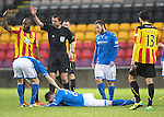 Partick Thistle v St Johnstone....14.12.13    SPFL<br /> Gary McDonald lies injured on the ground after a clash of heads left him with a cut above the eye<br /> Picture by Graeme Hart.<br /> Copyright Perthshire Picture Agency<br /> Tel: 01738 623350  Mobile: 07990 594431