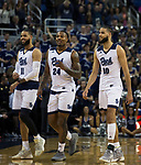 Nevada seniors Cody Martin (11), Jordan Caroline (24) and  Caleb Martin (10) come off the floor at Lawlor Events Center for the last time at the end of their NCAA college basketball game against San Diego State in Reno, Nev., Saturday, March 9, 2019. (AP Photo/Tom R. Smedes)