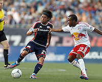 New England Revolution midfielder Lee Nguyen (24) dribbles as New York Red Bulls forward Dane Richards (19) defends. In a Major League Soccer (MLS) match, New England Revolution defeated New York Red Bulls, 2-0, at Gillette Stadium on July 8, 2012.