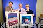 Artist John Hurley, left, with Kerry's Eye marketing director Brendan Kennelly and editor Colin Lacey, and the two paintings to be won in our latest competition..