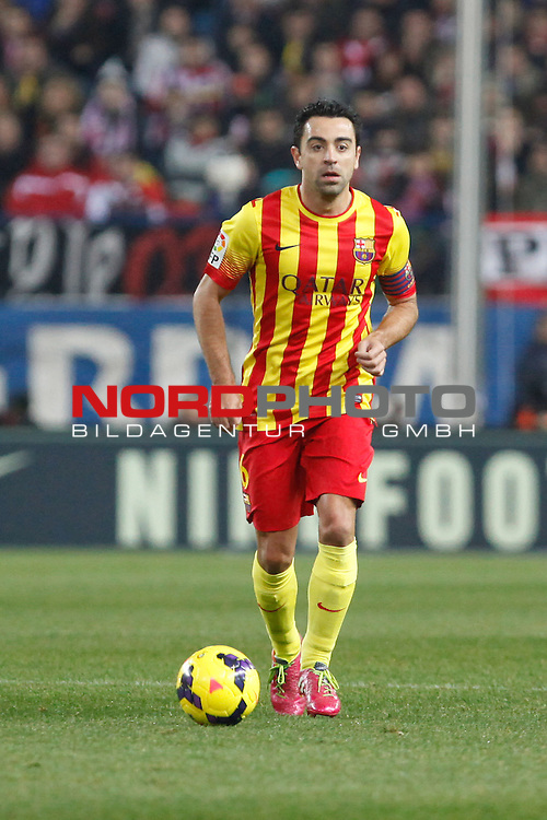 Barcelona¬¥s Xavi during La Liga match at Vicente Calderon stadium in Madrid, Spain. January 11, 2014. Foto © nph / Victor Blanco)