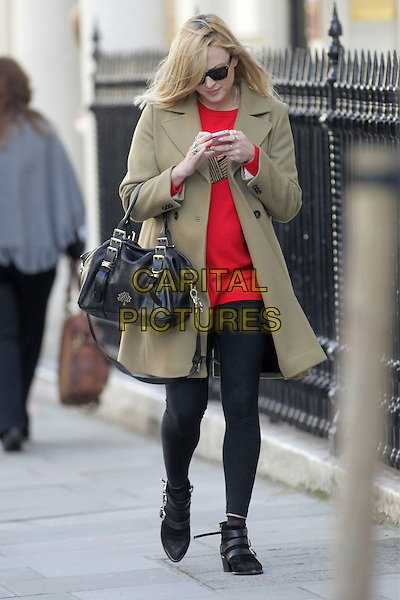 Fearne Cotton in central London, England..October 12th, 2012.full length sunglasses shades beige camel coat jacket red top dress black tights boots bag purse mulberry pregnant mobile phone.CAP/HIL.©John Hillcoat/Capital Pictures .