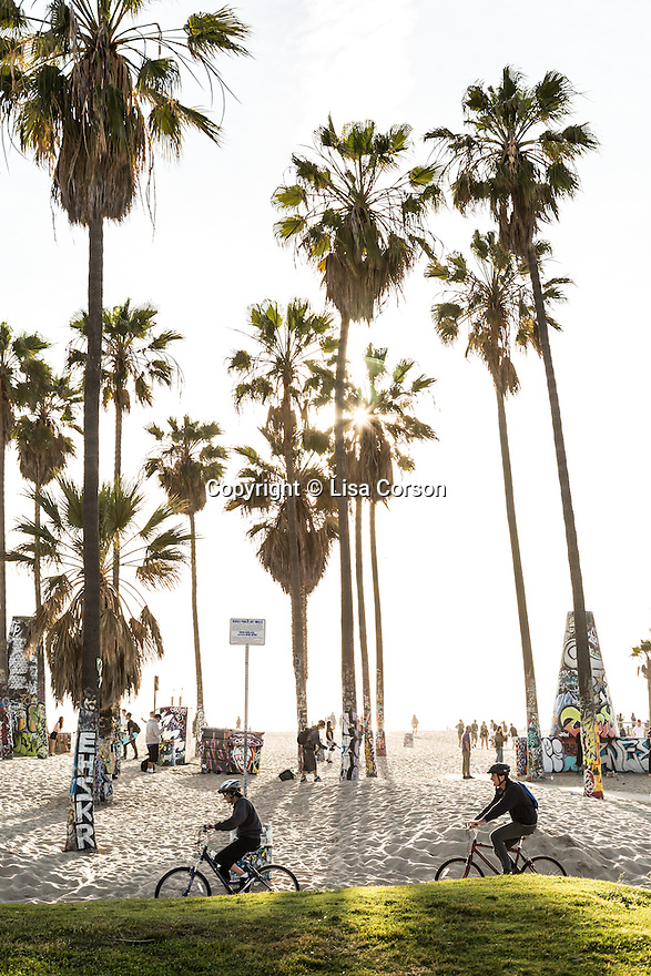 Cyclists ride between Santa Monica and Venice on the oceanside bike path. Venice, California. Los Angeles area.