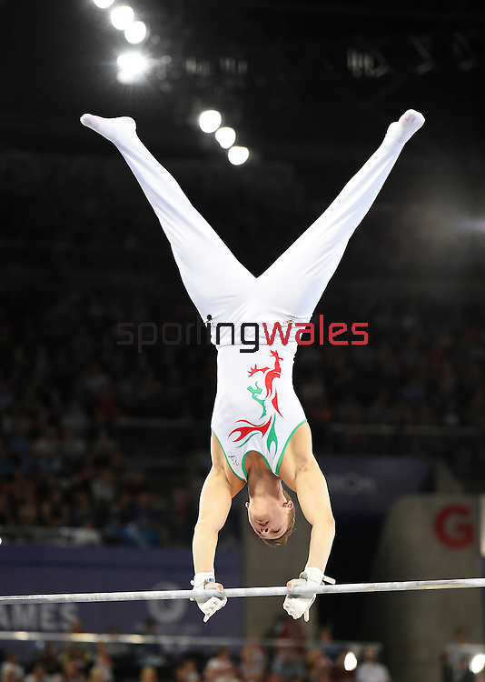 Wales' Harry Owen during his routine on the horizontal bar in the WAG individual qualification and team final<br /> <br /> Photographer Chris Vaughan/SPORTINGWALES<br /> <br /> 20th Commonwealth Games - Day 6 - Tuesday 29th July 2014 - Gymnastics Artistic - The SSE Hydro - Glasgow - UK