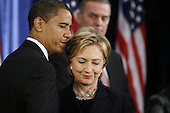 Chicago, IL - December 1, 2008 -- United States President-Elect Barack Obama talks to United States Senator Hillary Rodham Clinton (Democrat of New York), who Obama nominated for Secretary of State, at a press conference to introduce her and other security advisers Monday morning, December 1, 2008 at the Chicago Hilton & Towers in Chicago, Illinois. .Credit: Anne Ryan - Pool via CNP