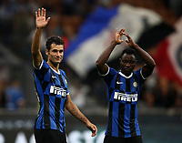 Calcio, Serie A: Inter Milano - Lecce, Giuseppe Meazza stadium, September 26 agosto 2019.<br /> Inter's Antonio Candreva (l) and Kwadwo Asamoah (r) celebrate after winning 4-0 the Italian Serie A football match between Inter and Lecce at Giuseppe Meazza (San Siro) stadium, September August 26,, 2019.<br /> UPDATE IMAGES PRESS/Isabella Bonotto