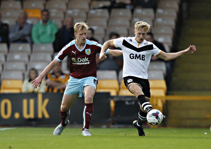 Burnley's Ben Mee battles with  Port Vale's A J Leitch-Smith<br /><br />Photographer Mick Walker/CameraSport<br /><br />Football - Capital One Cup First Round - Port Vale v Burnley - Tuesday 11th August 2015 - Vale Park - Burslem<br /> <br />&copy; CameraSport - 43 Linden Ave. Countesthorpe. Leicester. England. LE8 5PG - Tel: +44 (0) 116 277 4147 - admin@camerasport.com - www.camerasport.com