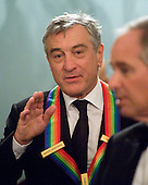 Washington, DC - December 5, 2009 -- Robert De Niro gestures as he and the other 2009 Kennedy Center honorees prepare to pose for the formal group photo following the Artist's Dinner at the United States Department of State in Washington, D.C. on Saturday, December 5, 2009.  .Credit: Ron Sachs - Pool via CNP