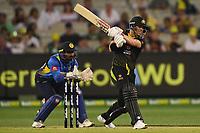 1st November 2019; Melbourne Cricket Ground, Melbourne, Victoria, Australia; International T20 Cricket, Australia versus Sri Lanka; David Warner of Australia smashes the bal - Editorial Use