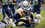 Aug 15, 2014; Seattle, WA, USA;  Seattle Seahawks wide receiver Bryan Walters (19) is tackled by San Diego Chargers special team Branden Oliver (43), San Diego Chargers linebacker Reggie Walker (52) and San Diego Chargers special teams Dontrelle Allen (15) during the first half at CenturyLink Field. Mandatory Credit: James Snook-USA TODAY Sports