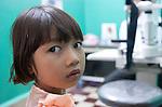Kim Thia, 6 prepares for her eye examination at Preah Ang Duong Hospital in Phnom Penh, Cambodia.