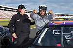 Wake Forest Demon Deacons offensive lineman A'Lique Terry climbs into a NASCAR race car at the Charlotte Motor Speedway on December 26, 2017 in Concord, North Carolina.  (Brian Westerholt/Sports On Film)
