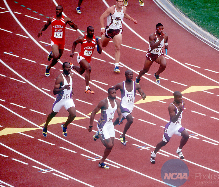 5 June 1996: Texas Christian anchor Percy Spencer takes the baton from Syan Williams to set an NCAA record in the 400 meter relay in the 1998 Division I track and field championships.  TCUâ time of 38.04 broke the schoolâ own NCAA record set in 1989.  Louisana State was second at the finish line in the championships held in blustery cold conditions at the SUNY-Buffalo Stadium.  Rich Clarkson/NCAA Photos