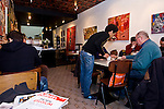 BRUSSELS - BELGIUM - 07 JANUARY 2012 -- Marolles the bohemian city part of Brussels. -- Cafe Aksum, Ethiopian cafe specialized in Ethiopian coffee. first time client Frans van de Wiele (ri) being served by Dawid (Eritrea) -- PHOTO: Juha ROININEN /  EUP-IMAGES