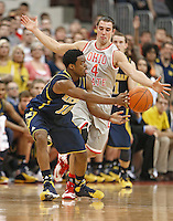 Ohio State Buckeyes guard Aaron Craft (4) applies defensive pressure to Michigan Wolverines guard Derrick Walton Jr. (10) in second half action at Nationwide Arena on February 11,  2014. (Chris Russell/Dispatch Photo)