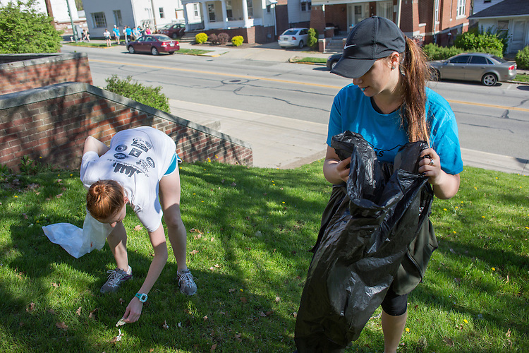 Junior Anna Gillen, left, and sophomore Emma Gohmann, right, both members of Alpha Phi Omega, a service fraternity at Ohio University, pick up trash during Athens Beautification Day on April 17, 2016.