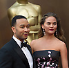 John Legend and Chrissy Teigan<br /> 86TH OSCARS<br /> The Annual Academy Awards at the Dolby Theatre, Hollywood, Los Angeles<br /> Mandatory Photo Credit: &copy;Dias/Newspix International<br /> <br /> **ALL FEES PAYABLE TO: &quot;NEWSPIX INTERNATIONAL&quot;**<br /> <br /> PHOTO CREDIT MANDATORY!!: NEWSPIX INTERNATIONAL(Failure to credit will incur a surcharge of 100% of reproduction fees)<br /> <br /> IMMEDIATE CONFIRMATION OF USAGE REQUIRED:<br /> Newspix International, 31 Chinnery Hill, Bishop's Stortford, ENGLAND CM23 3PS<br /> Tel:+441279 324672  ; Fax: +441279656877<br /> Mobile:  0777568 1153<br /> e-mail: info@newspixinternational.co.uk