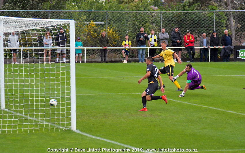 Ben Waine beats Scott Basalaj to score his first goal during the ISPS Handa Premiership football match between Team Wellington and Wellington Phoenix Reserves at David Farrington Park in Wellington, New Zealand on Sunday, 17 November 2019. Photo: Charley Lintott / lintottphoto.co.nz