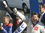 December 11, 2012, Tokorozawa, Japan - Bundled up in a warm coat, Shinzo Abe of the Liberal Democratic Party leads three cheers during a stumping stop at Tokorozawa, Tokyo's western suburbs, on Monday, December 11.2012. With a general election less than a week away, Abe7s LDP is leading far ahead of Prime Minister Yoshihiko Noda's Democratic Party of Japan.  (Photo by Natsuki Sakai/AFLO) AYF -mis-