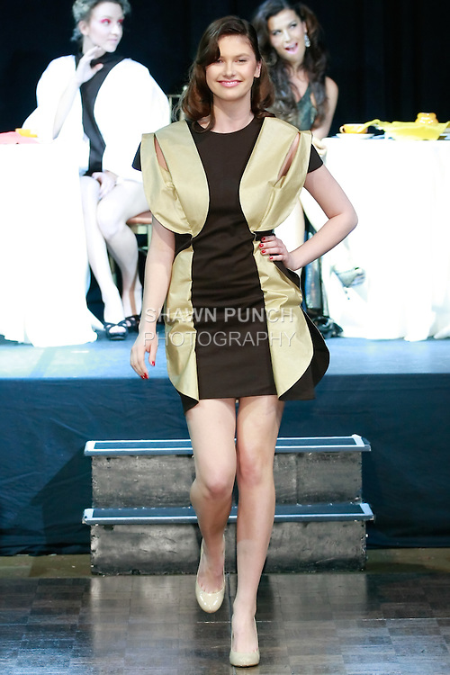 """Model walks runway in an outfit from the """"Flavour of Coffee"""" collection by Annamaria Kiss Kosa, during Slovak Fashion Night 2012 in New York City May 11, 2012."""