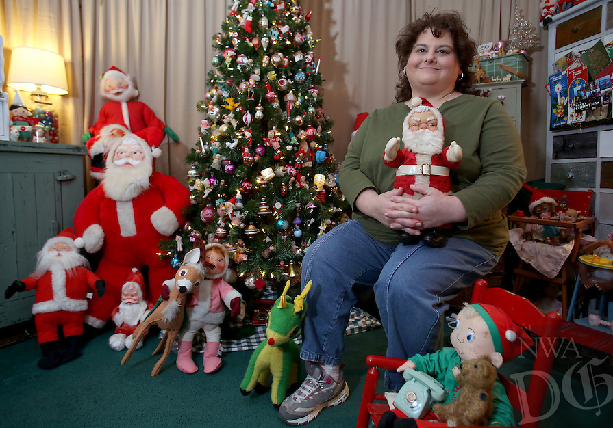 NWA Democrat-Gazette/DAVID GOTTSCHALK  Shara Stacks sits Thursday, December 15, 2016, in her favorite personal space, the retro and antique Christmas decorated living room of her home in Farmington.