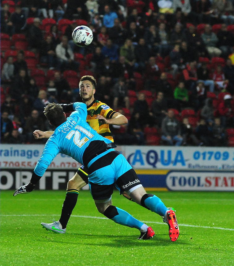 Norwich City's Ricky van Wolfswinkel heads the ball into the goal, past Rotherham United's Adam Collin, but his effort was ruled out for offside<br /> <br /> Photographer Chris Vaughan/CameraSport<br /> <br /> Football - Capital One Cup Second Round - Rotherham United v Norwich - Tuesday 25th August 2015 - New York Stadium - Rotherham<br />  <br /> &copy; CameraSport - 43 Linden Ave. Countesthorpe. Leicester. England. LE8 5PG - Tel: +44 (0) 116 277 4147 - admin@camerasport.com - www.camerasport.com