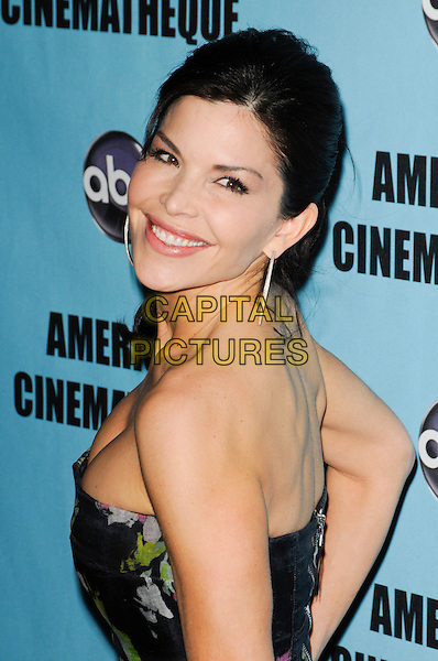 LAUREN SANCHEZ .at the 24th Annual American Cinematheque Awards at the Beverly Hilton Hotel in Beverly Hills, California, USA, March 27th, 2010.  .portrait headshot hoop earrings cleavage hair up strapless green black floral print silver looking back over shoulder smiling side .CAP/ROT.©Lee Roth/Capital Pictures.