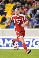 Austin Berry (24) of the Louisville Cardinals. The Louisville Cardinals defeated the Notre Dame Fighting Irish 1-0 during the semi-finals of the Big East Men's Soccer Championship at Red Bull Arena in Harrison, NJ, on November 12, 2010.