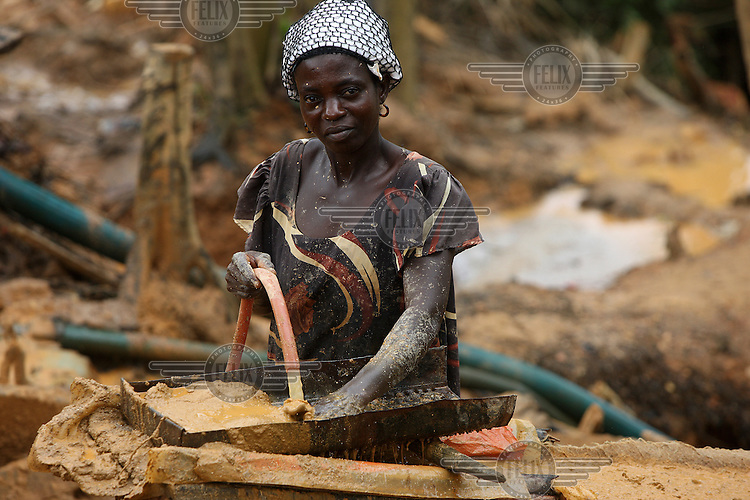 A local woman works on a gold mining site in Obuasi. Many unemployed young people have taken to working as illegal artisanal gold miners known as galamseys in Ghana.