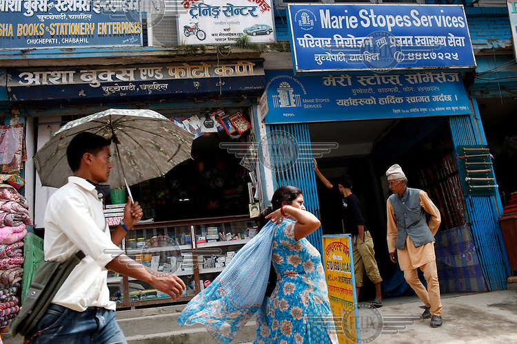 People walk past a Marie Stopes Services clinic for sexual health.