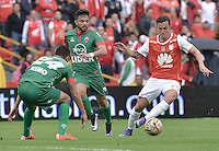 BOGOTÁ -COLOMBIA, 02-04-2016. Luis Manuel Seijas (Der.) jugador de Santa Fe disputa el balón con Juan Sebastian Villota (C) y Deiver Parra (Izq.) jugadores de Patriotas durante partido entre Independiente Santa Fe y Patriotas FC por la fecha 11 de la Liga Aguila I 2016 jugado en el estadio Nemesio Camacho El Campin de la ciudad de Bogota.  / Luis Manuel Seijas (R) player of Santa Fe struggles for the ball with Juan Sebastian Villota (C) and Deiver Parra (L) players of Patriotas during match between Independiente Santa Fe and Patriotas FC for date 11 of the Liga Aguila I 2016 played at the Nemesio Camacho El Campin Stadium in Bogota city. Photo: VizzorImage/ Gabriel Aponte / Staff