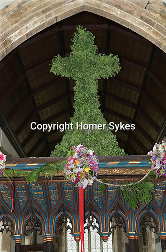 Charlton-on-Otmoor Oxfordshire Ist of May Day Celebrations. Children from the Church of England St Mary the Virgin Primary School process to the village church to have their May garlands blessed. The garlands are then hung on the church Rood Screen. The decorated cross and garlands.