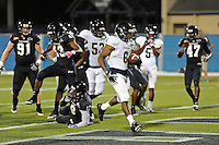 30 March 2012:  FIU's Jeremiah Harden (6) carries the ball for a touchdown at the FIU Football Spring Game at University Park Stadium in Miami, Florida.