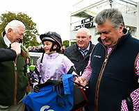 Megan Nicholls, jockey of Moabit talks to an owner as dad Paul Nicholls makes a call after winning The Byerley Stud 'Season Finale' Handicap  during Bathwick Tyres Reduced Admission Race Day at Salisbury Racecourse on 9th October 2017