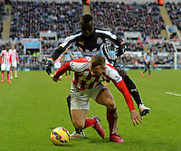 Phillip Bardsley of Stoke City fends off Papiss Cisse of Newcastle United