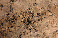 Precolumbian pictogram of a shaman or sorcerer by the indigenous Tainos culture, in the Cueva de la Linea or Cueva del Ferrocaril, created by limestone erosion, in the Parque Nacional de los Haitises, or Los Haitises National Park, on the North East coast of the Dominican Republic, in the Caribbean. The paintings were made using berry juice, mangrove bark, charcoal, manatee grease and bat droppings. The park was established in 1976 and consists of limestone karst scenery, mountains, subtropical forest and mangrove forests along the coast. Picture by Manuel Cohen